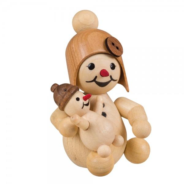 Schneemann mit Puppe